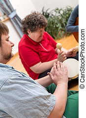 Music therapy with a mentally disabled woman - a music...