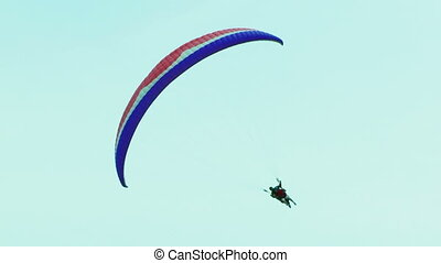 Two Paragliders On One Palaplane Soaring Over Beautiful...
