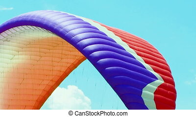 Paraglider Soaring Over Green Hill - Camera is following a...