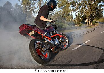Motorcycle Stunt - Biker guy doing a stunt with his motobike...