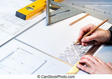 Architect planning home layout. - Macro close up of...