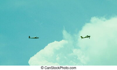 Glider Towing Plane High In the Sky - Two frames: glider is...