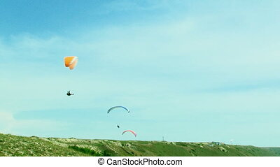 Several Paragliders Soaring In the Sky - Locked down footage...