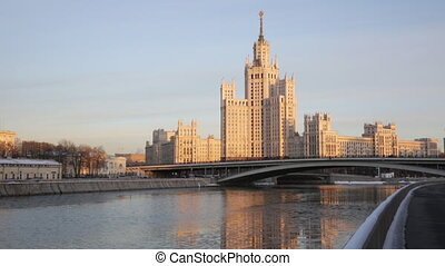 high-rise building on Kotelnicheskaya Embankment in winter twilight, Moscow