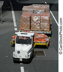 airport vehicle - Airport vehicle transporting cargo to...