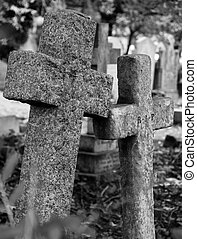 2 stone cross tombstones - two old stone crosses at a...