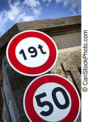 Road signs - Two road signs on a stone wall