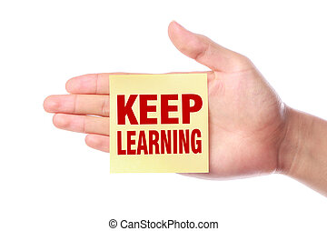 Keep learning - Hand with Keep learning sticky note is...