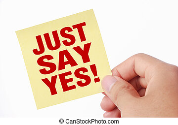Just say yes - Hand with Just say yes sticky note is...