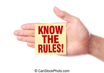 Know the rules - Hand with Know the rules sticky note is...