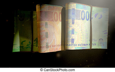 Rand Note Bundles Assorted - A close-up view of three wads...