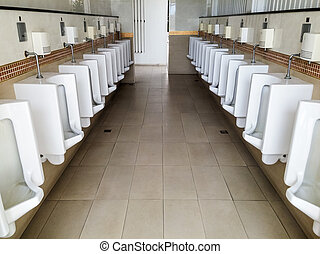 White urinals row in the clean public restroom
