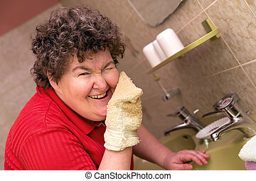mentally disabled woman with a washcloth - a happy mentally...