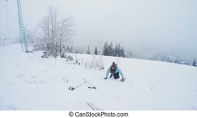 Fallen woman - After skiing girl fell and crying
