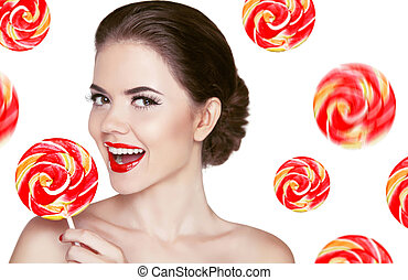 Happy smiling girl holding colorful lollipop isolated on white b