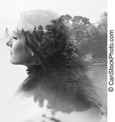 nature of the woman - double exposure of young female and...