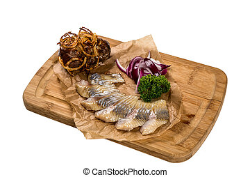 Restourant serving dish - pieces herring for snack on white...