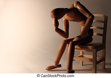 worried wooden dummy sitting with copy space