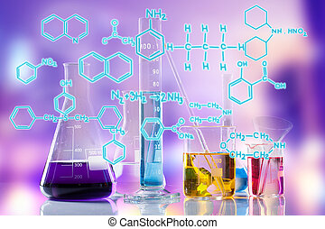 Laboratory tubes with colored liquids inside and formula on...