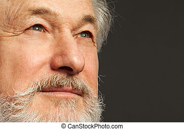 Handsome, elderly man with white beard