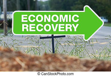 Economic Recovery Sign - A green sign points the way to...