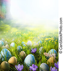 Art Easter eggs on meadow with daffodil flower - Easter eggs...