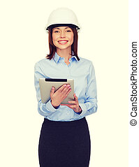 young smiling businesswoman in white helmet - building,...