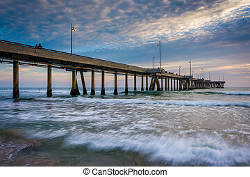 Waves in the Pacific Ocean and the pier at sunset, in Venice Bea