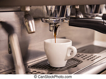 Barista - Close-up of an espresso machine making a cup of...
