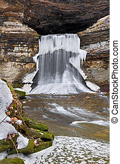Winter at Porter Cave - Water flowing from the mouth of...