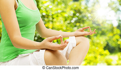 Yoga Meditation, Sitting Outdoors in Lotus Pose, Woman Meditatin