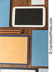 Tablet and office stationery - Tablet with blank screen and...