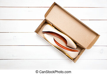 shoes in a box - beige shoes flats in a box on a white...