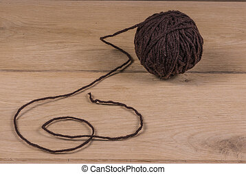 Wool ball - Image of brown wool ball, wood background close...