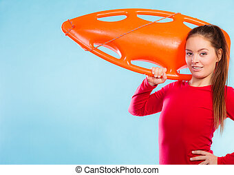 Girl lifeguard with equipment float - Accident prevention...