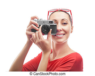 Girl with the camera. Beautiful girl in red, the camera...