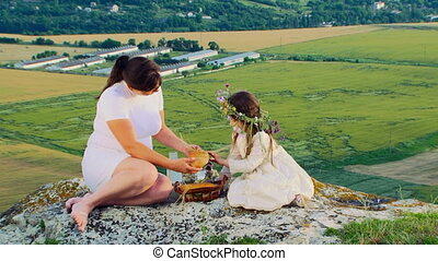 Mother With Little Daughter Having Lunch At Nature - Mother...