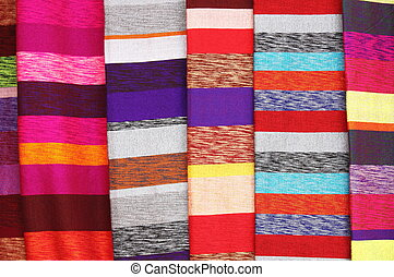 Colorful scarves hanging in a market stall in Morocco