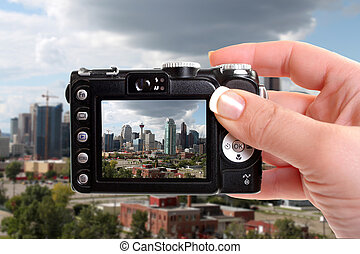 Taking snapshot of Calgary - Skyline view of highrise office...