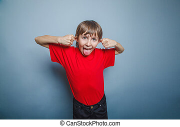 Boy, teenager, twelve years in the red shirt, pulled ears, -...