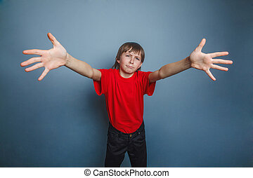 boy, teenager, twelve years old, wearing a red shirt,...