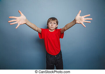 boy, teenager, twelve years old, a in red shirt, stretched...