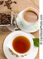 coffee and tea on linen background - coffee, coffee beans...