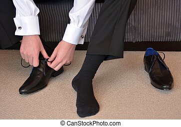 Man wearing elegant men shoes - Man (bridegroom) wearing...