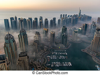 foggy weather Dubai Marina - sunrise aerial view skyscraper...