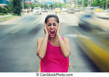 Portrait business woman screaming at street car traffic -...