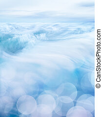 Rolling Wave Bokeh - Small ocean waves with bokeh effects in...