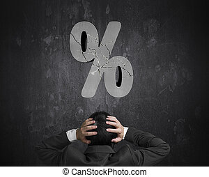 Businessman hand head with cracked percentage sign on...