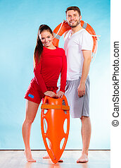 lifeguards on duty with equipment - Accident prevention and...