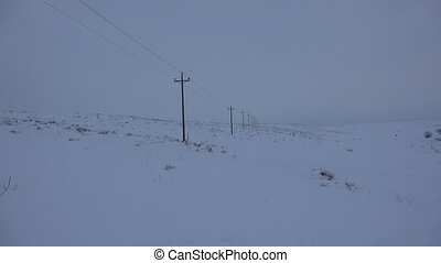 Endless Telephone Poles Carry Life - The winter view of...